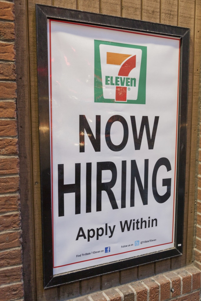 Pittsburgh, Pennsylvania, USA March 30, 2012. Now Hiring sign in a 7 Eleven Shop. The Pennsylvania minimum wage is the same as the U.S. federal wage which is $7.25 an hour.