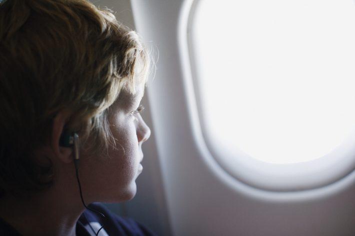 Child-on-Plane-iStock-77188141-710x473