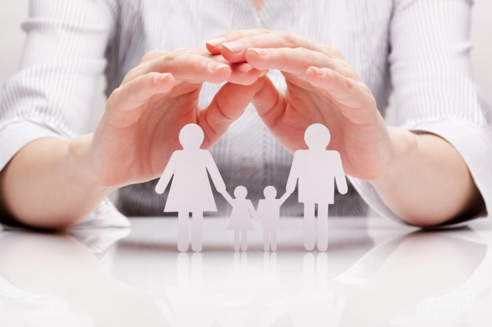 Hands-Covering-Paper-Family-iStock-166769374-1-710x473