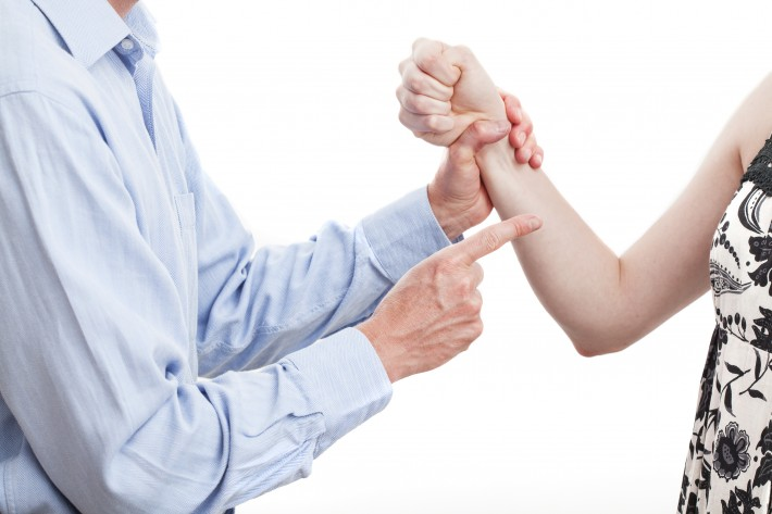 Husband-holding-wifes-arm-iStock_27356059-710x473