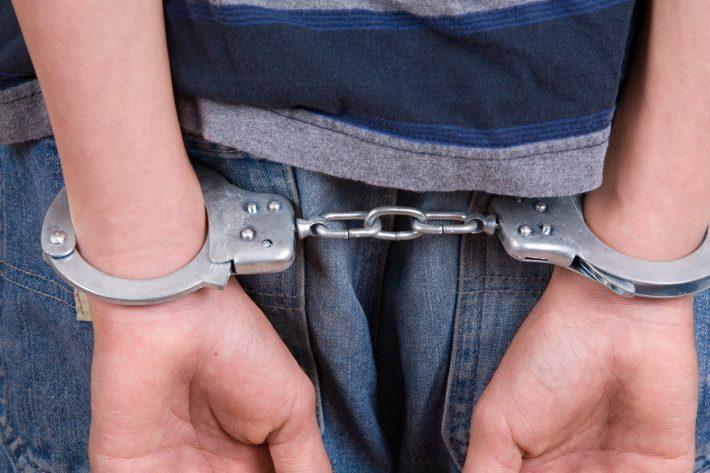 Kid-in-Handcuffs-iStock-174546155-710x473