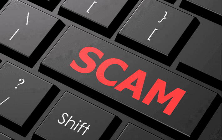 Scam-on-keyboard-cropped-710x447