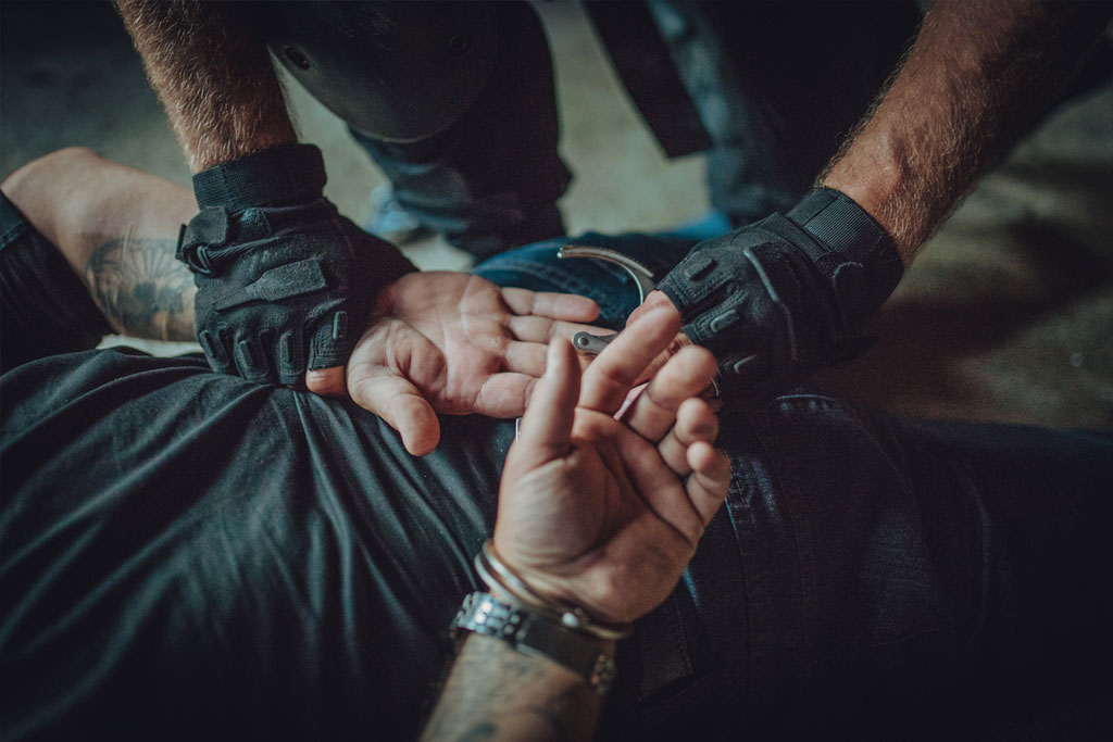 Image of police arresting a suspect